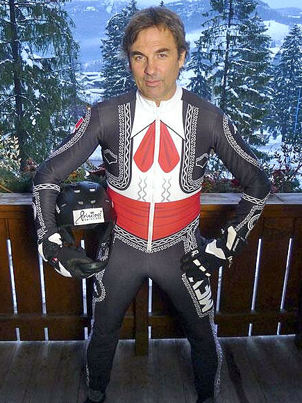 He is Prince Hubertus of Hohenlohe-Langenburg and yes he is wearing a ski suit that looks like a Mariachi outfit. And he has balls made out of titanium (not pictured)